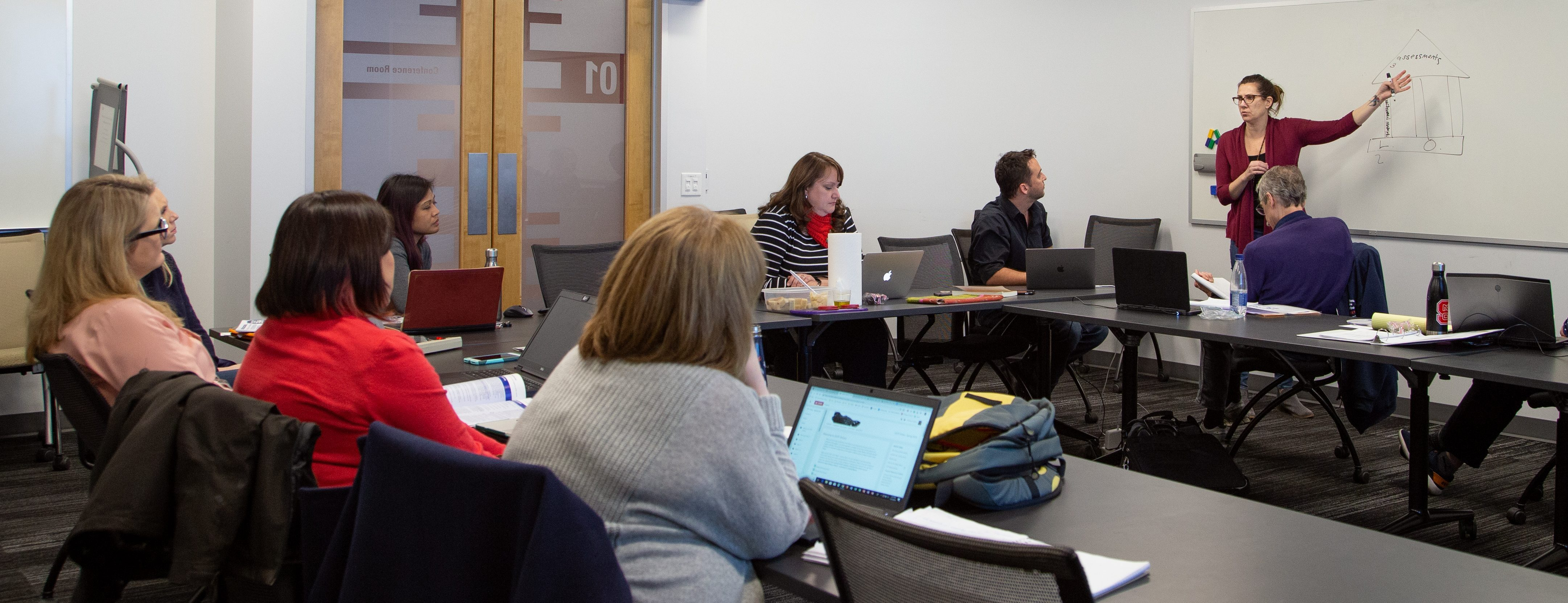 Faculty discussing course design best practices